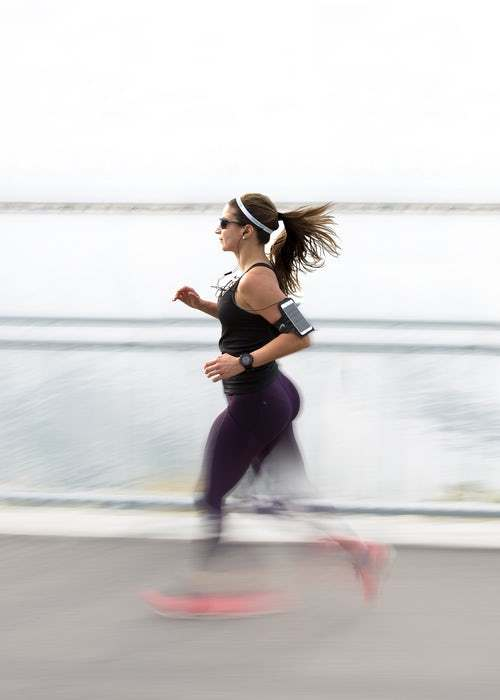 running woman with arm band- Photo by Filip Mroz on Unsplash
